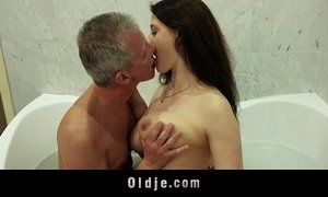 Busty nasty girl gives old man wet pleasing in the bathtub