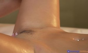 Lesbian masseuse Foxxi finger fucking her busty client during massage session