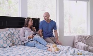 Johnny Sins competes with a long black vibrator in bed