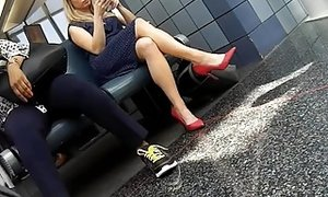 Candid gams and soles in crimson high-heeled slippers at Airport sextube